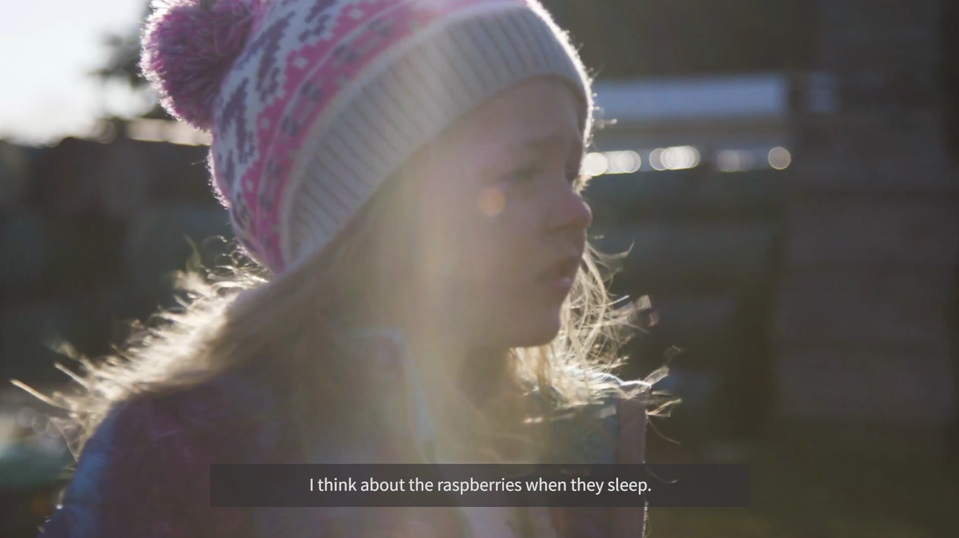 """child from Wild Hive saying """"I think about the raspberries when they sleep,"""" wearing winter hat"""