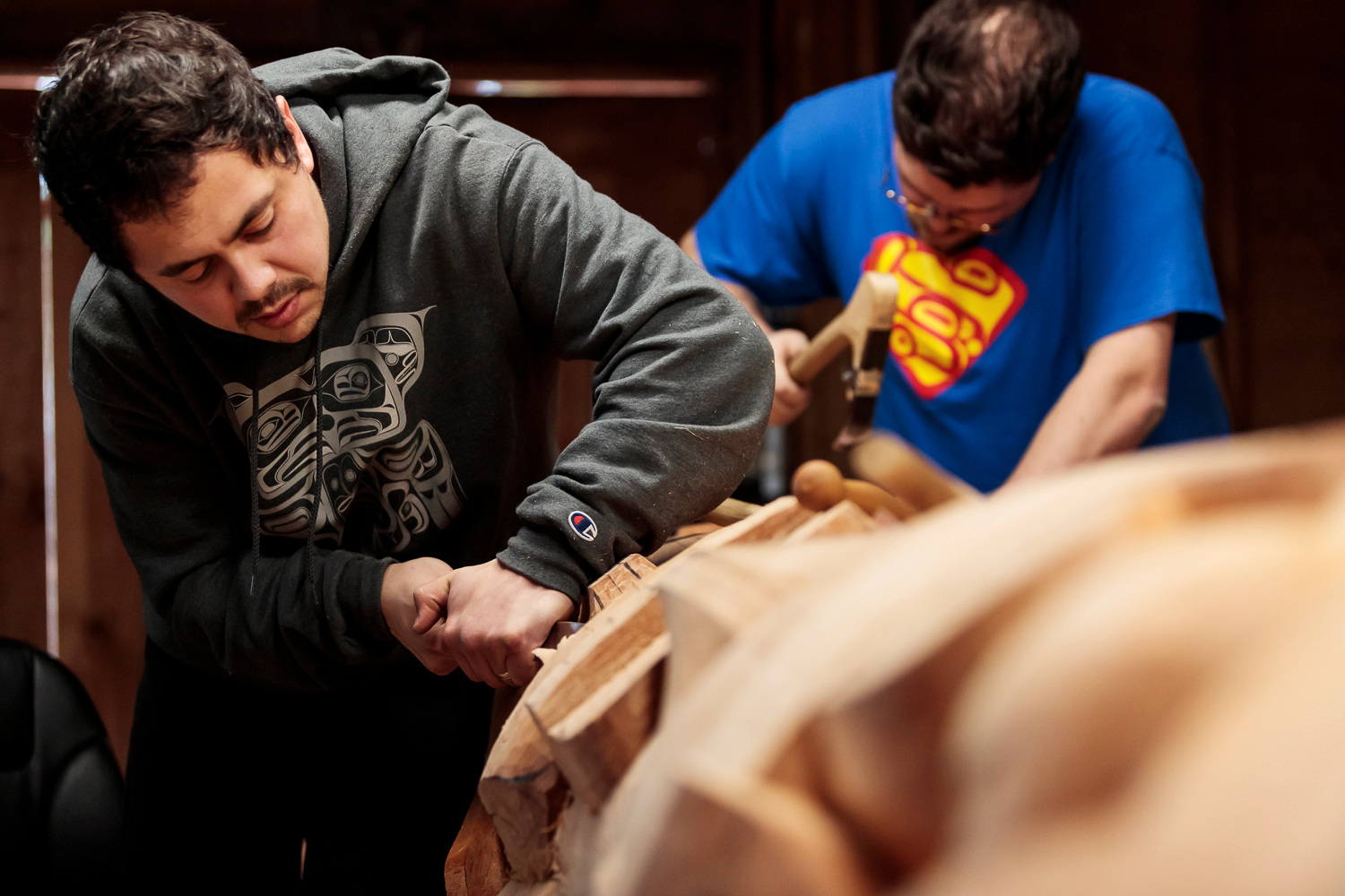 David Robert Boxley (back) and Clifton Guthrie (front) are Tsimshian Artist and Carvers living in Metlakatla, Alaska. When they were born 150 people spoke their native language. Now only, 3.