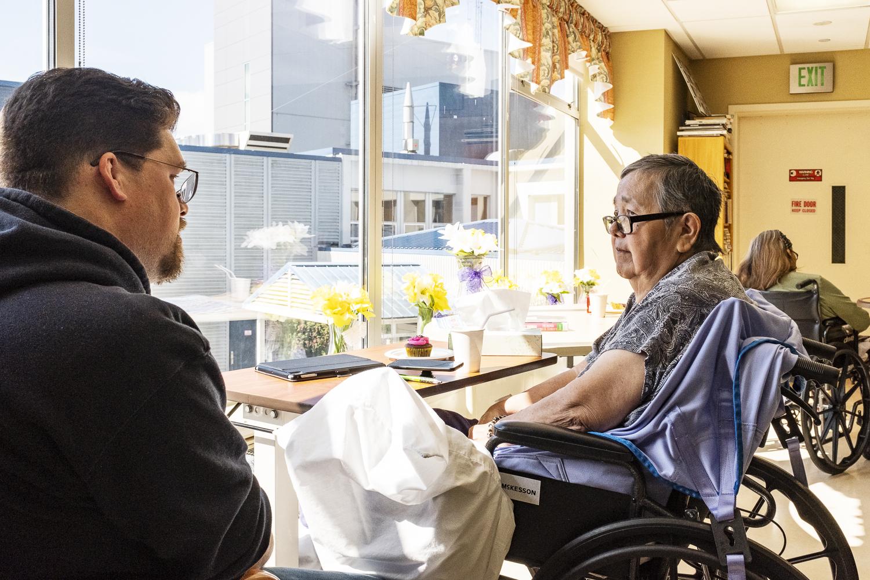 David Robert Boxley meeting with his Tsimshian language teacher, G̱oodm Nluułgm Xsgiik - Sarah Booth, in a hospital in Ketchikan, Alaska.