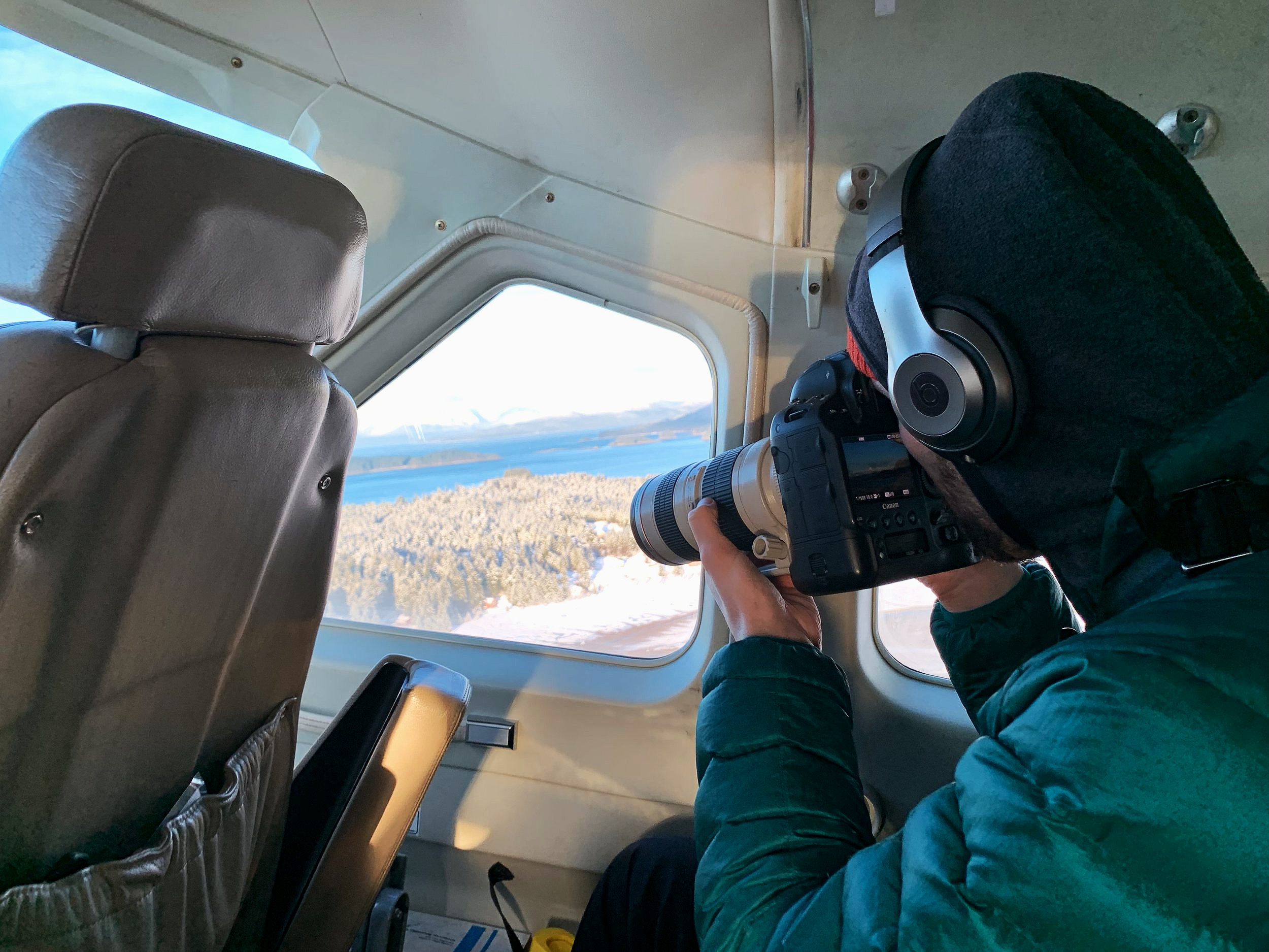 Soulcraft Allstar Photographer Brandon Sawaya in a Seaplane taking photos above Southeast Alaska.