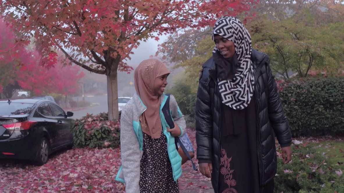 Halima and her mother Sara walking to the Seattle Public Library in their neighborhood.