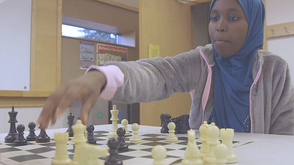 Halima checkmates her opponent in an after school chess program at her local branch of the Seattle Public Library.