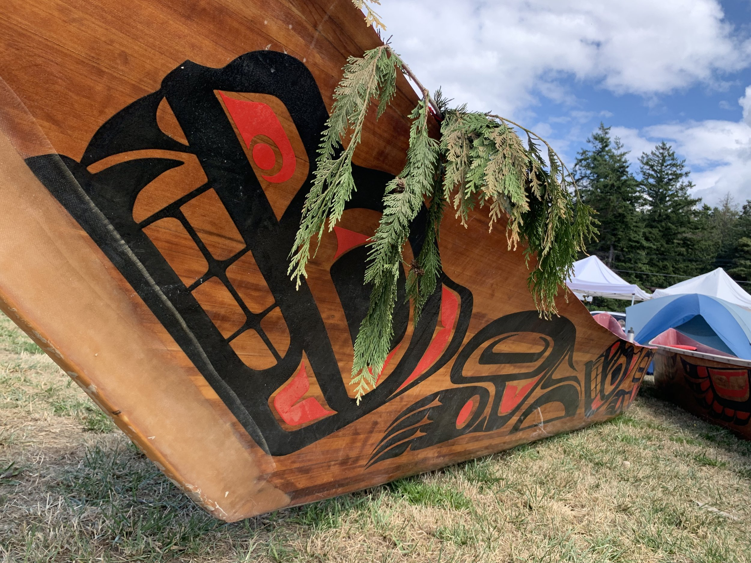 One of nearly 100 canoes paddle to Lummi Nation for the the 2019 Paddle to Lummi. Photo by Aaron Straight.
