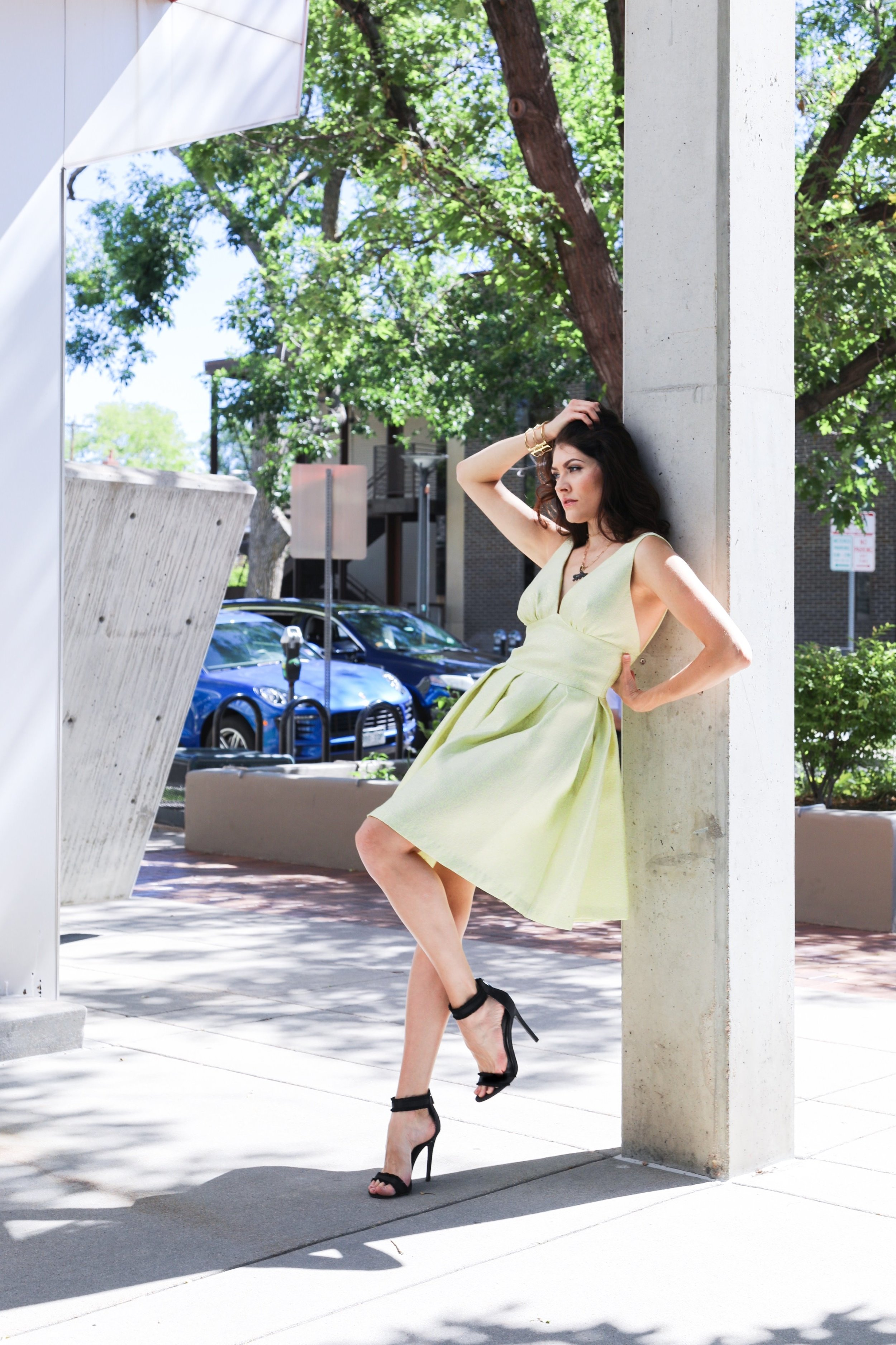 Model Hailey Spung on the corner of Milwaukee & 3rd Ave wearing yellow dress and jewelry from Mariel Boutique.