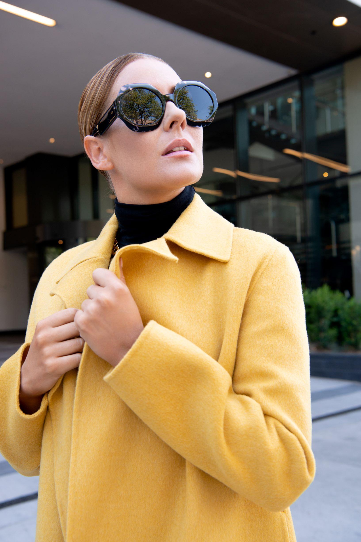 Dress: Veronic Beard, Coat: Theory, Turtleneck: Majestic, Booties: Valentino, Necklace: Lulu Frost, Bag: Simonetto Ravizza, Sunglasses: Dior