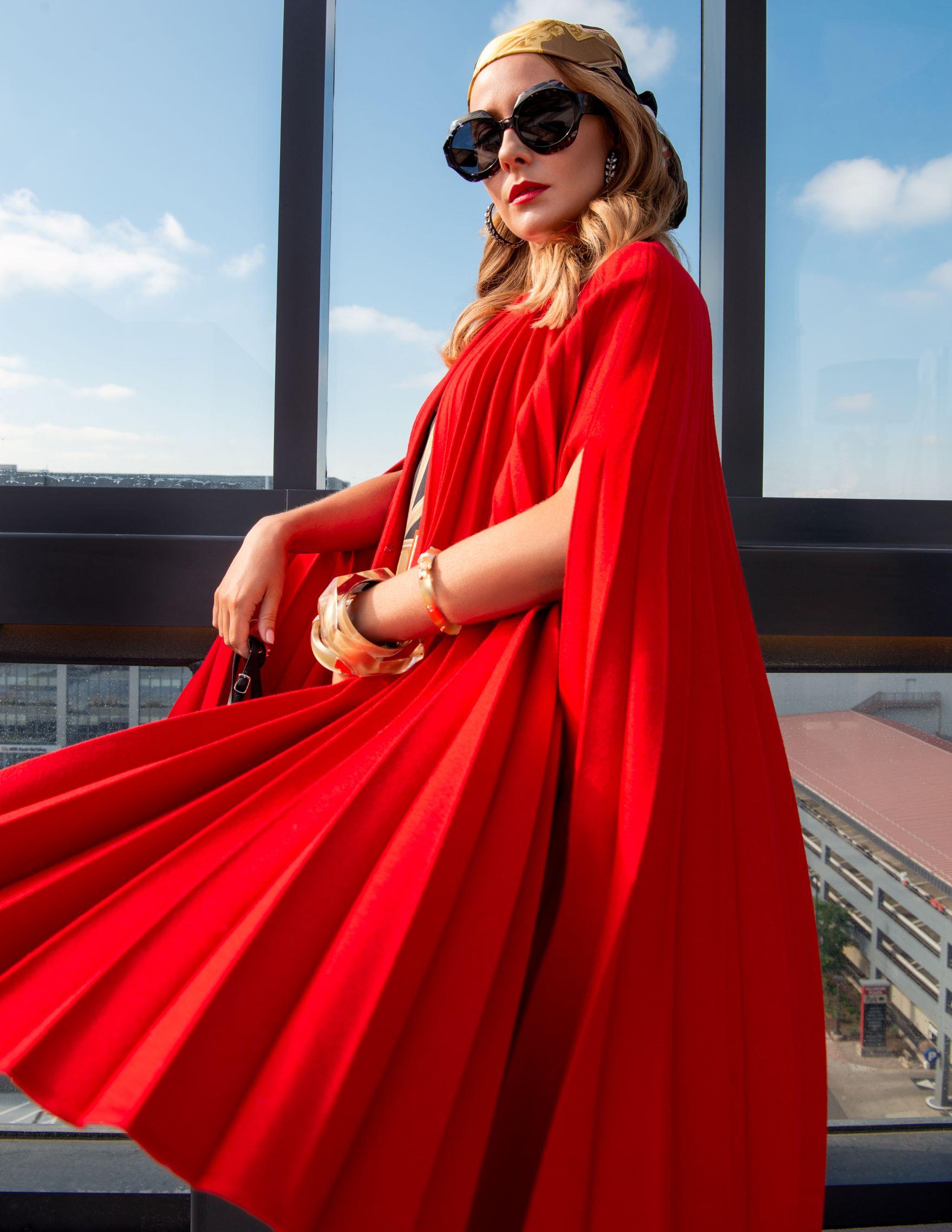 Dress: Burberry, Cape: Valentino, Sunglasses: Dior, Sandals: Balenciaga, Earrings: Oscar de la Renta, Bracelets: Alexis Bitar, Scarf: Burberry