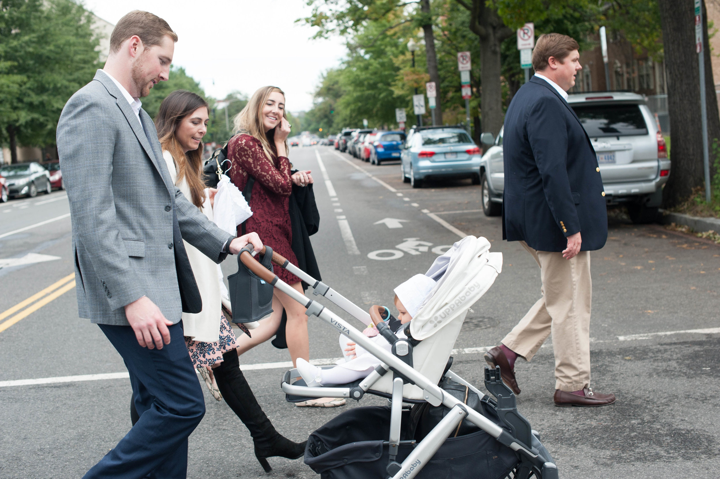 Parents, Godparents, and the Little Princess on their way to the church.