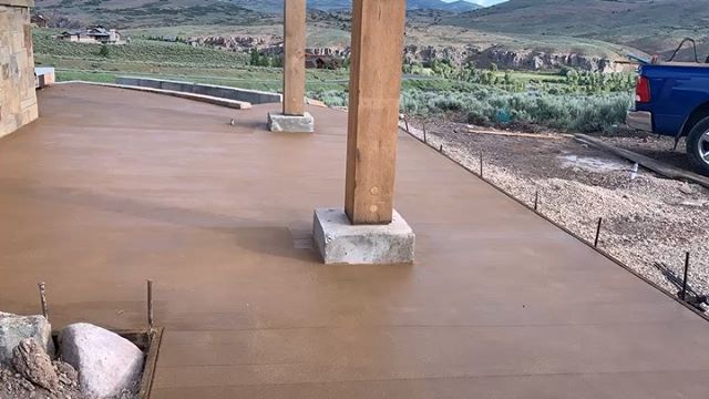A new colored patio in Victory Ranch. Who needs a new patio?  #concrete #architecture #engineering #construction #parkcity #saltlakecity #kamas #victoryranch #heber