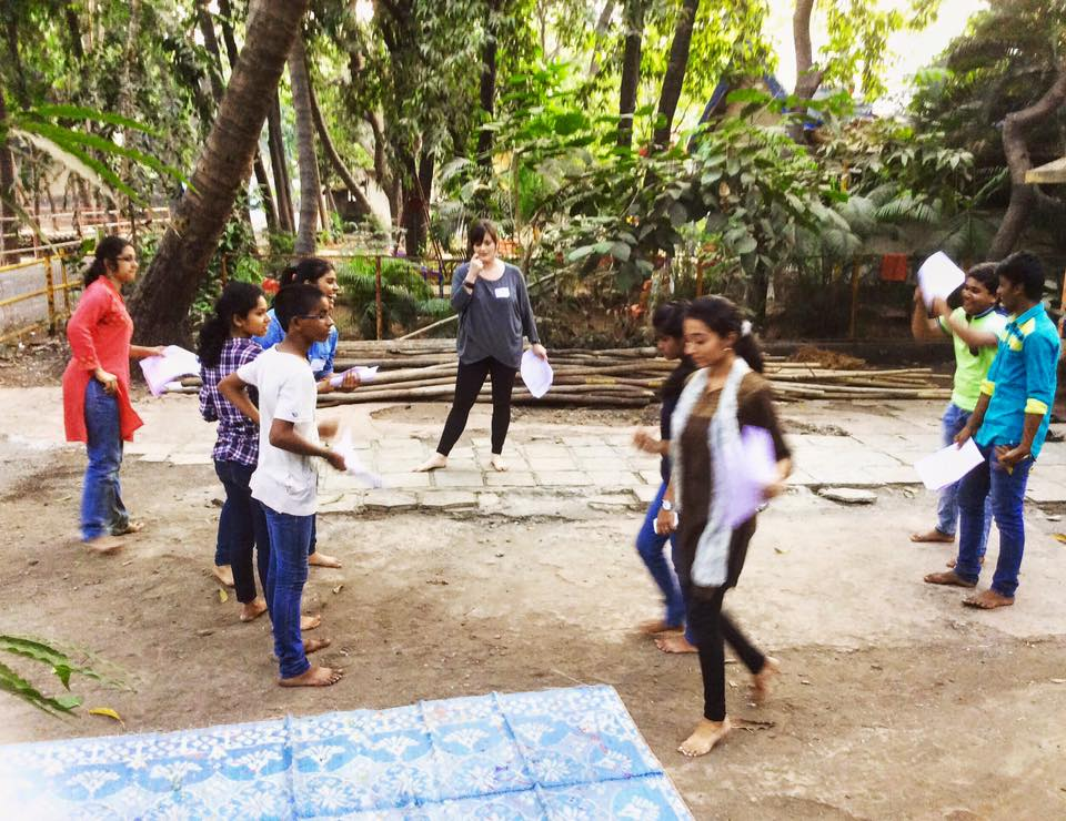 An image of Ashley devising a piece about the theme of forced marriage with college students in Mumbai, India through GETheatre.