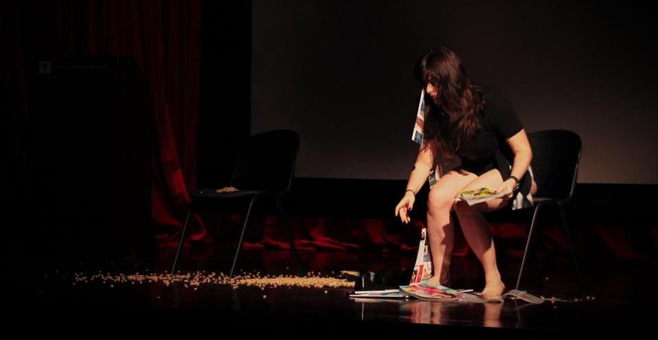 An image of Ashley performing her Master's Thesis  Disordered:  An Interview-Based Play about Body Image and Beauty in the United States at New York University.
