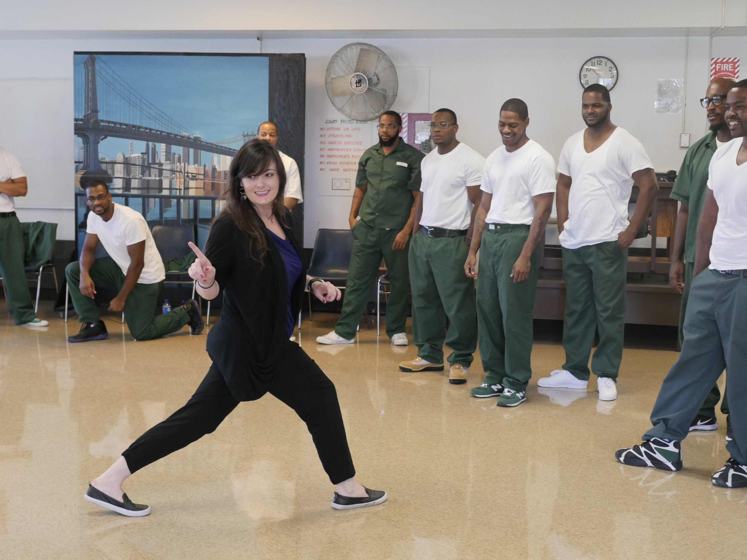 An image of Ashley directing the devised play  138  with the students of NYU's Prison Education Program at Wallkill Correctional Facility as part of her course Theatre for Social Change.