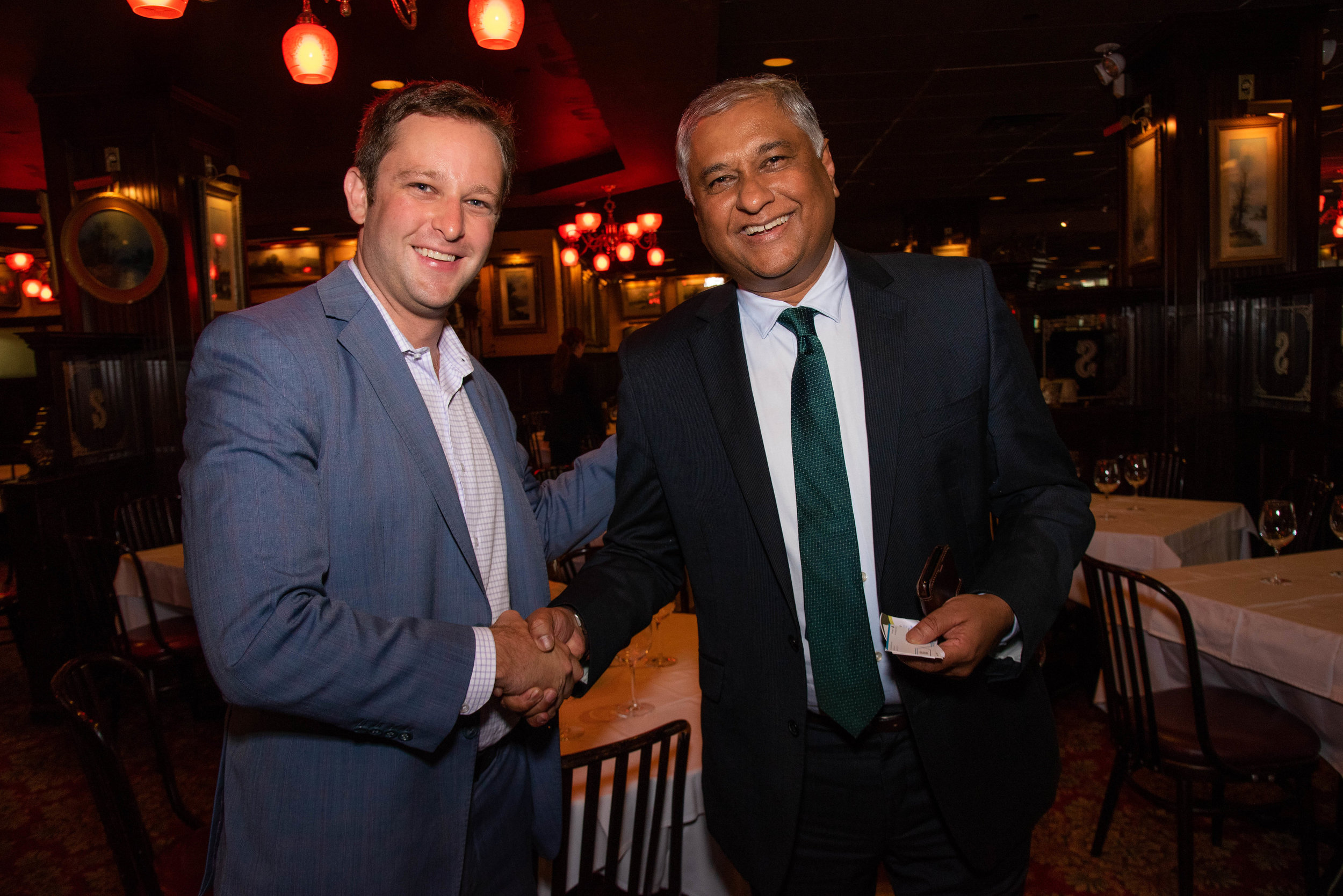 GridMarket CEO Nick Davis bonds with UN Ambassador Satyendra Prassad from Fiji over their shared optimism for the future.