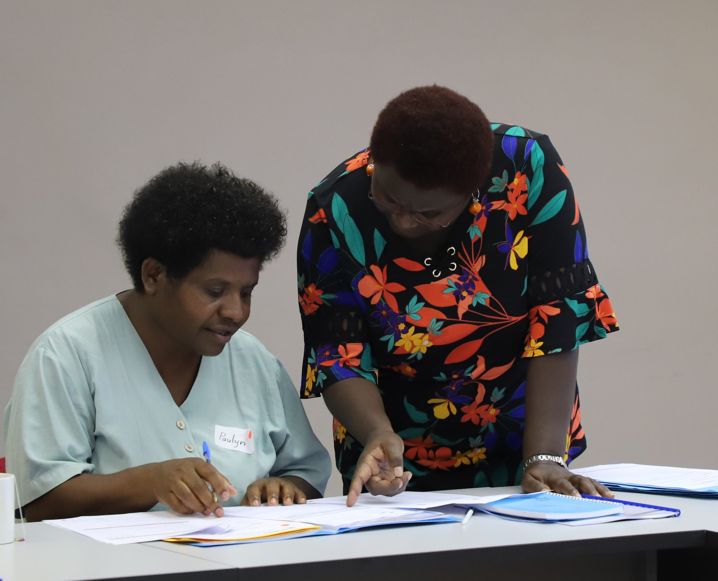 Sr. Pauline Rex (seated) of Pimaga Rural Hospital and a Wings PNG trainer during her first contact session in Port Moresby.