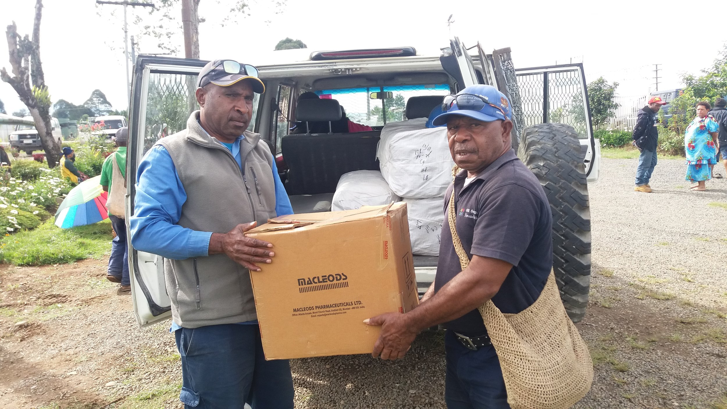 OSF staff load Long-lasting insecticidal nets (LLIN) in Hela.