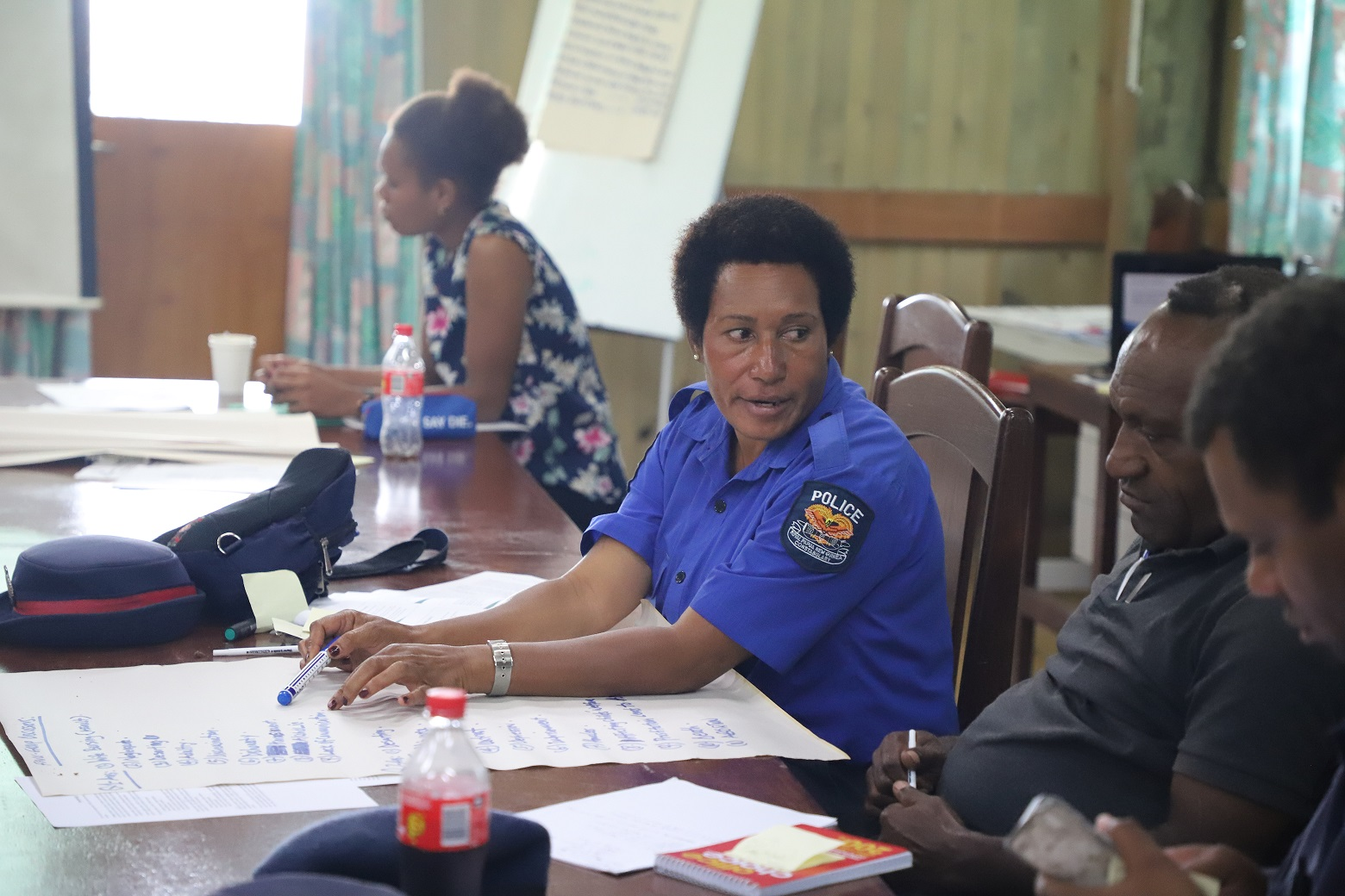 Corporal Christine Luke from the Moro Police Station participates in the group discussion.