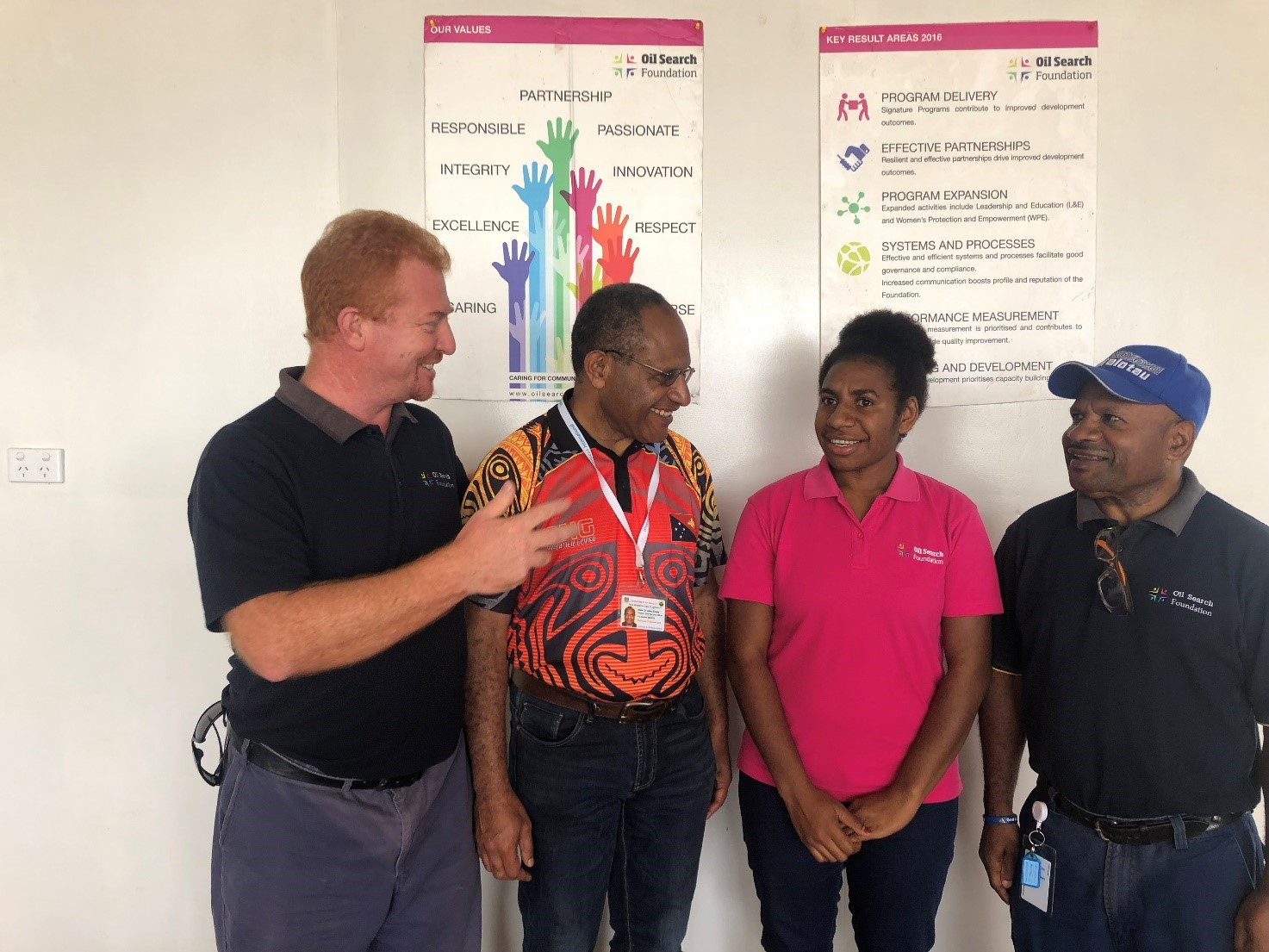 OSF staff in Hela, Hela PHA CEO Dr. James Kintwa (second from left) and Jasmine Tom (third from left) at Hela Provincial Hospital.
