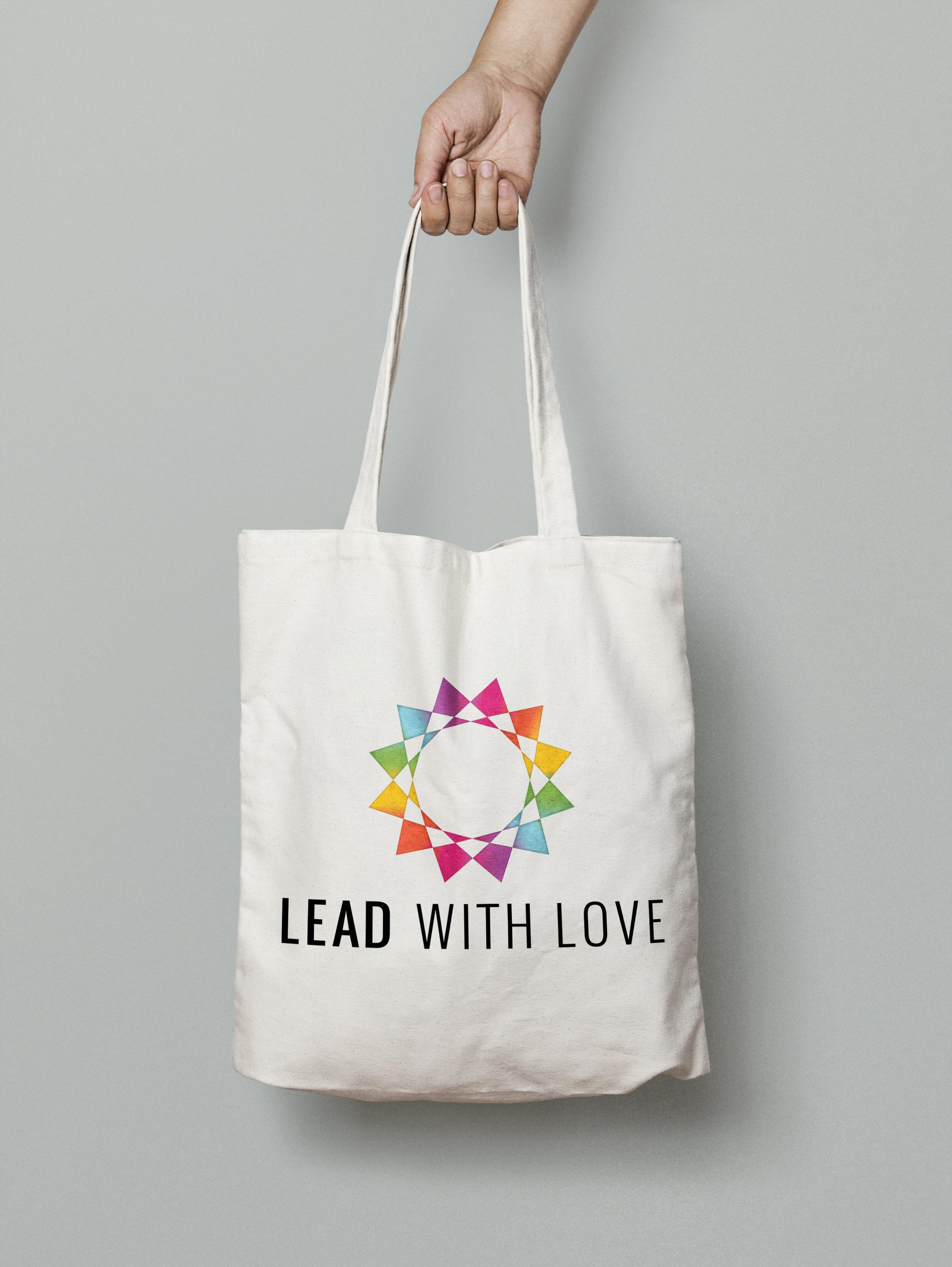 erica simon graphic designer lead with love aspen tote bag
