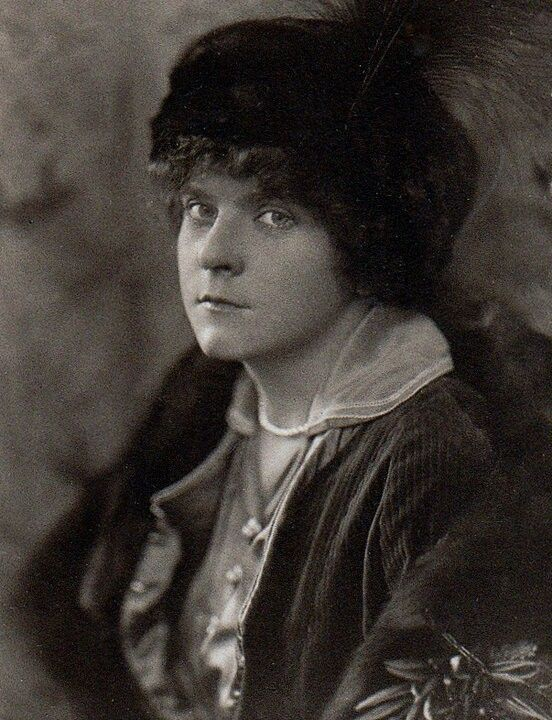 Elsa Lemp-Wright. Her eyes look so dismal but her lips look like she is just biting her tongue trying not to bitch some one out.