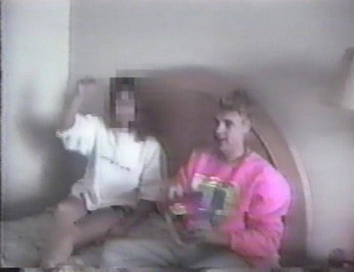 "A snap shot from the video that Homolka took of their ""act"" with Jane Doe."