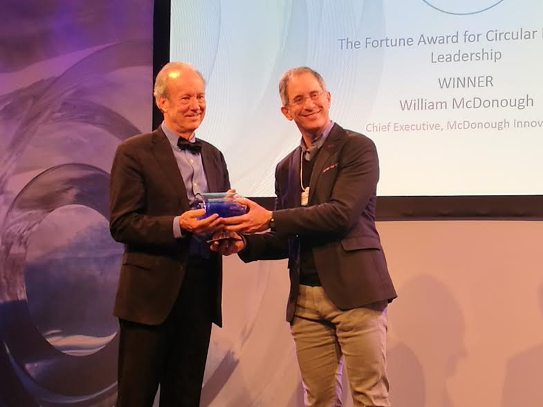 William McDonough, Chief Executive of McDonough Innovation, receives The Fortune Award for Circular Economy Leadership from Adam Lashinsky, Executive Editor for Fortune Magazine.
