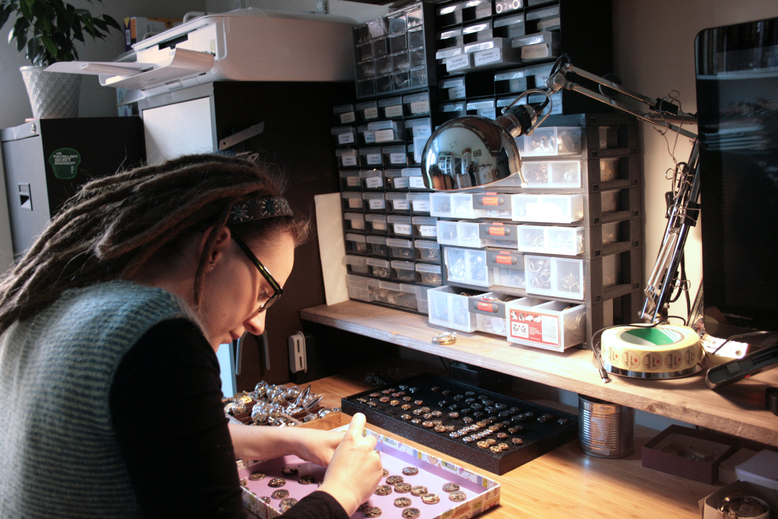 Eva Gifted Hands working on watch movement jewellery in he home studio.