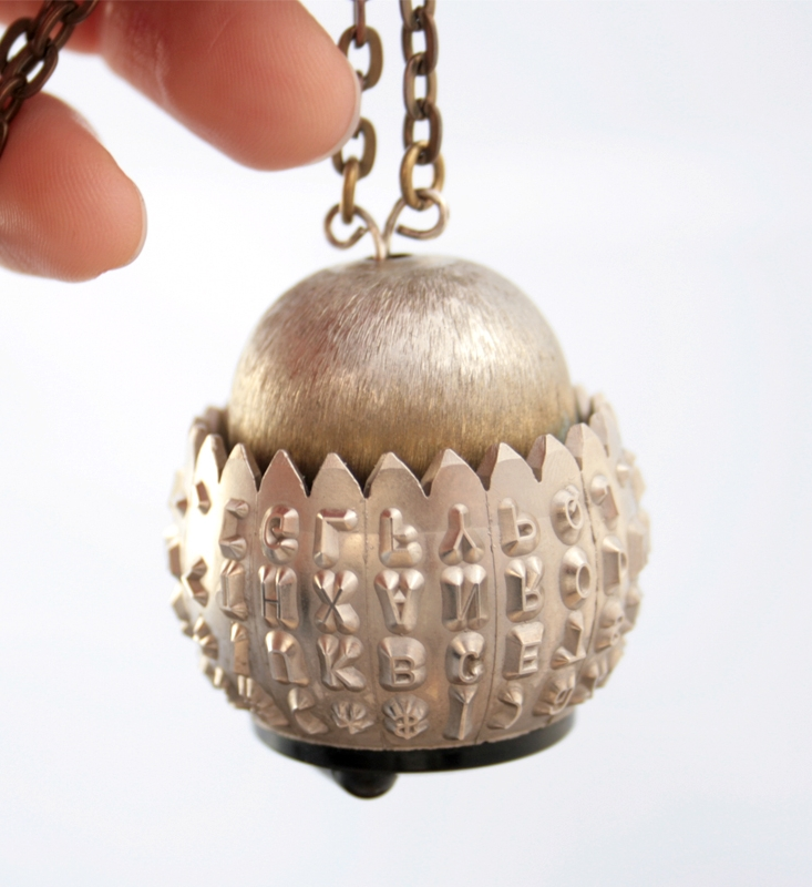 statement jewellery made of antique typewriter type ball