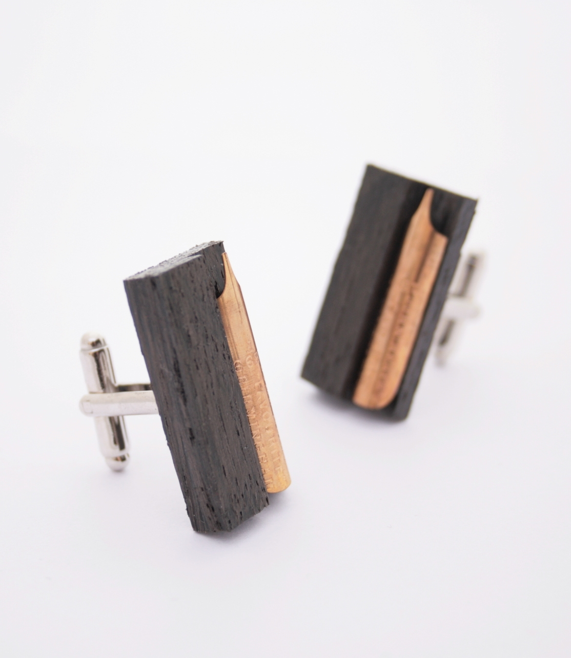 fountain pen nib large cufflinks on black oak