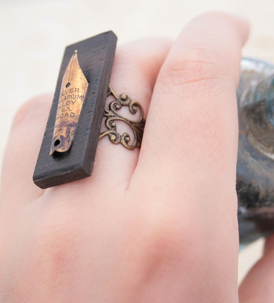 fountain pen nib on black oak statement ring for poet