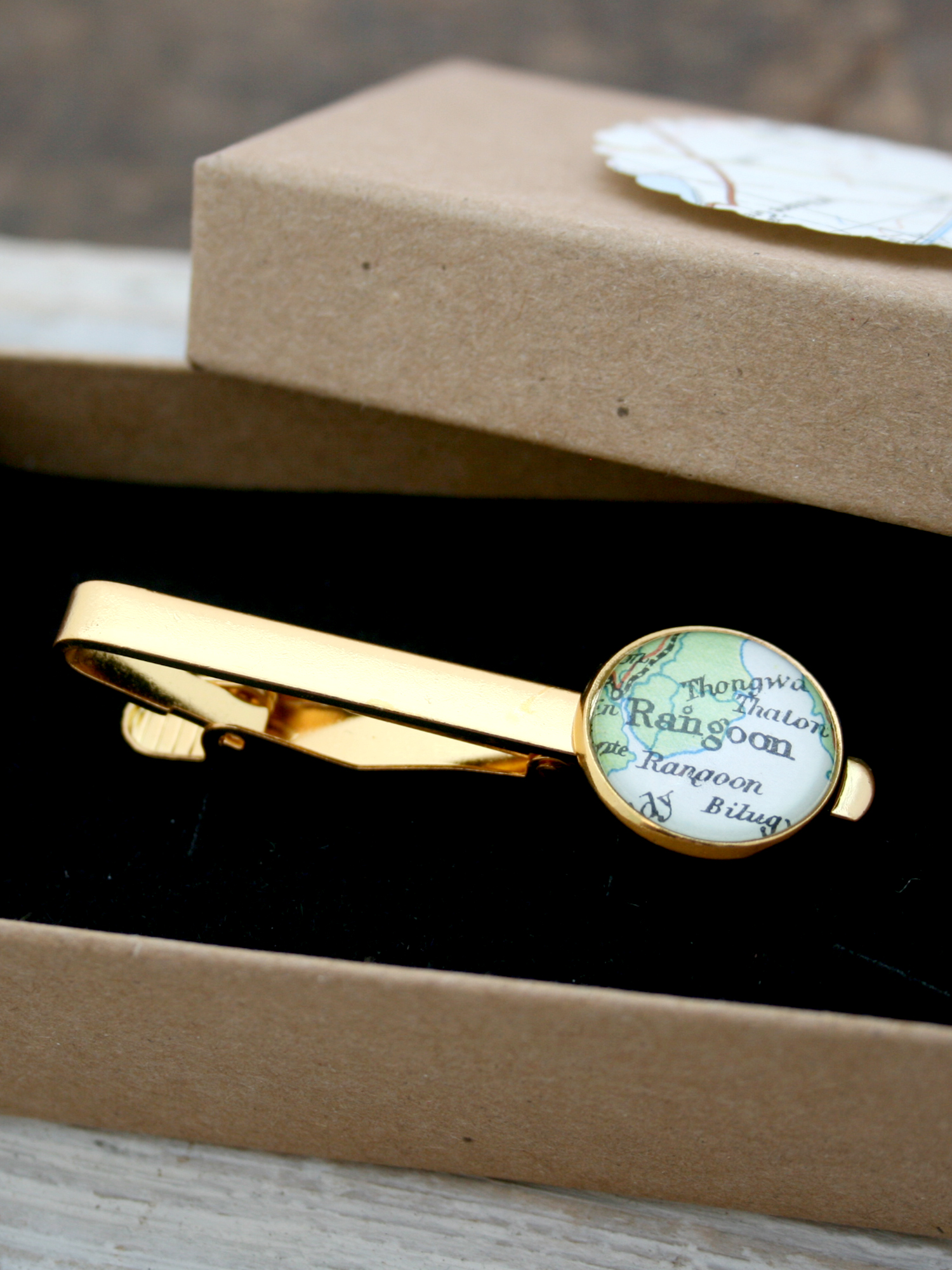 bespoke tie clip in gold tone with custom map selection
