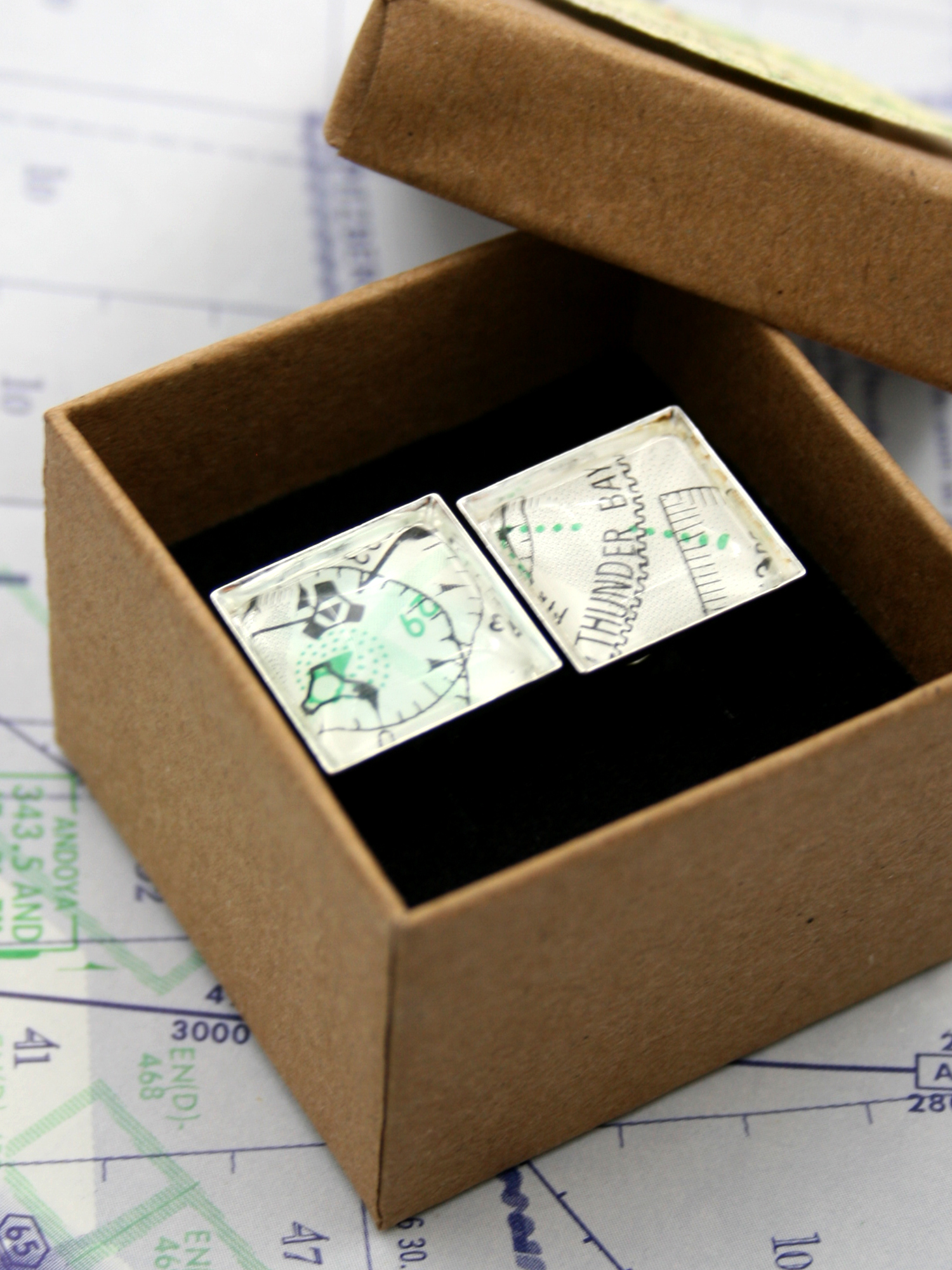 Personalized cuff-links with real aeronautical charts