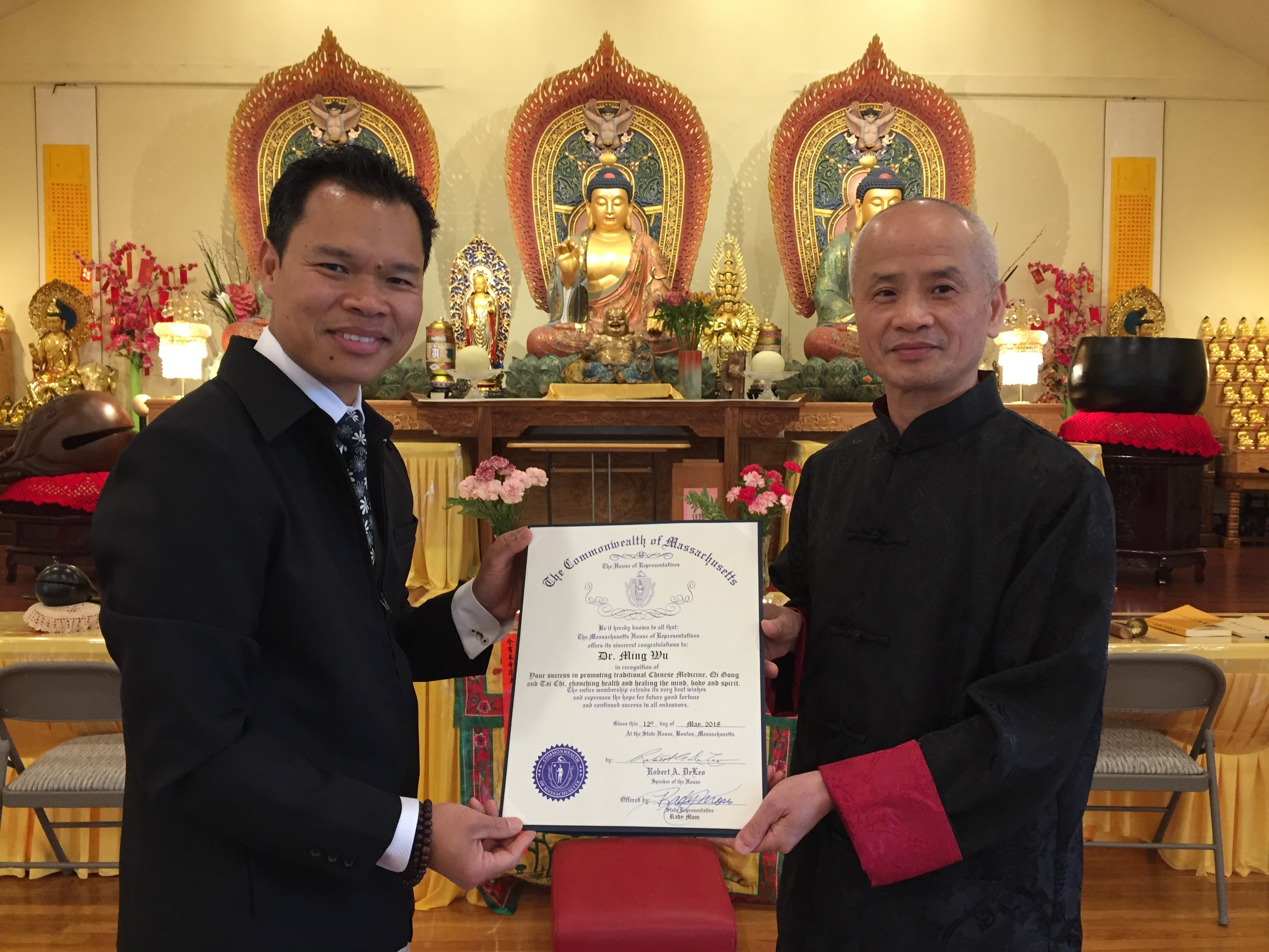 State Representative Rady Mom presenting citation from Massachusetts House of Representatives to Dr. Wu for his success in promoting TCM, Qi Gong and Tai Chi.