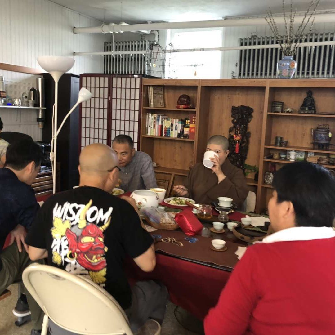 Enjoying vegetarian lunch and Wuyi mountain tea offered by Dr. Wu