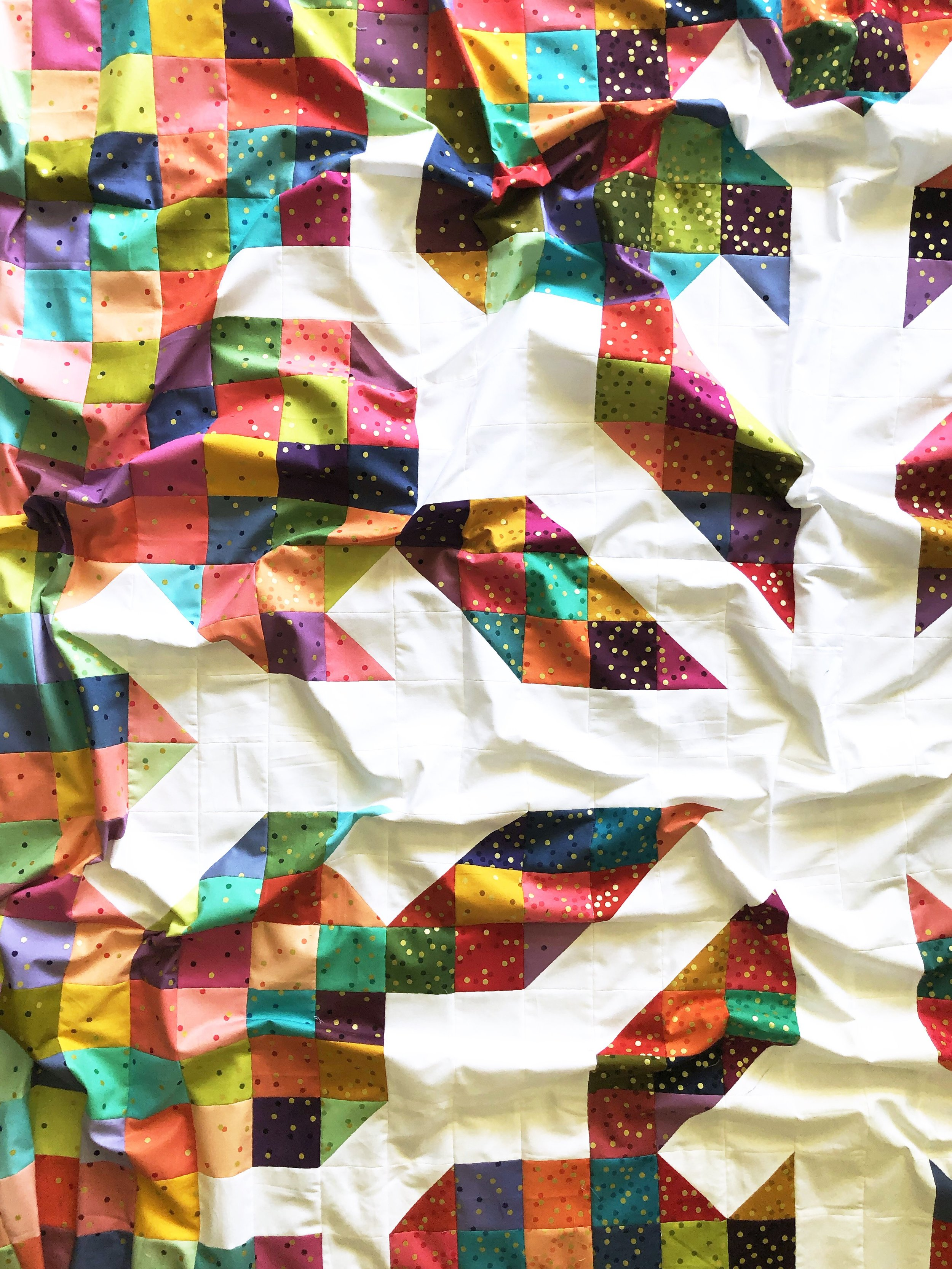 My most recent Snowflake quilt top finish - this one featuring a fun mix of V and Co. Ombré Confetti Metallic in the Scrappy version.