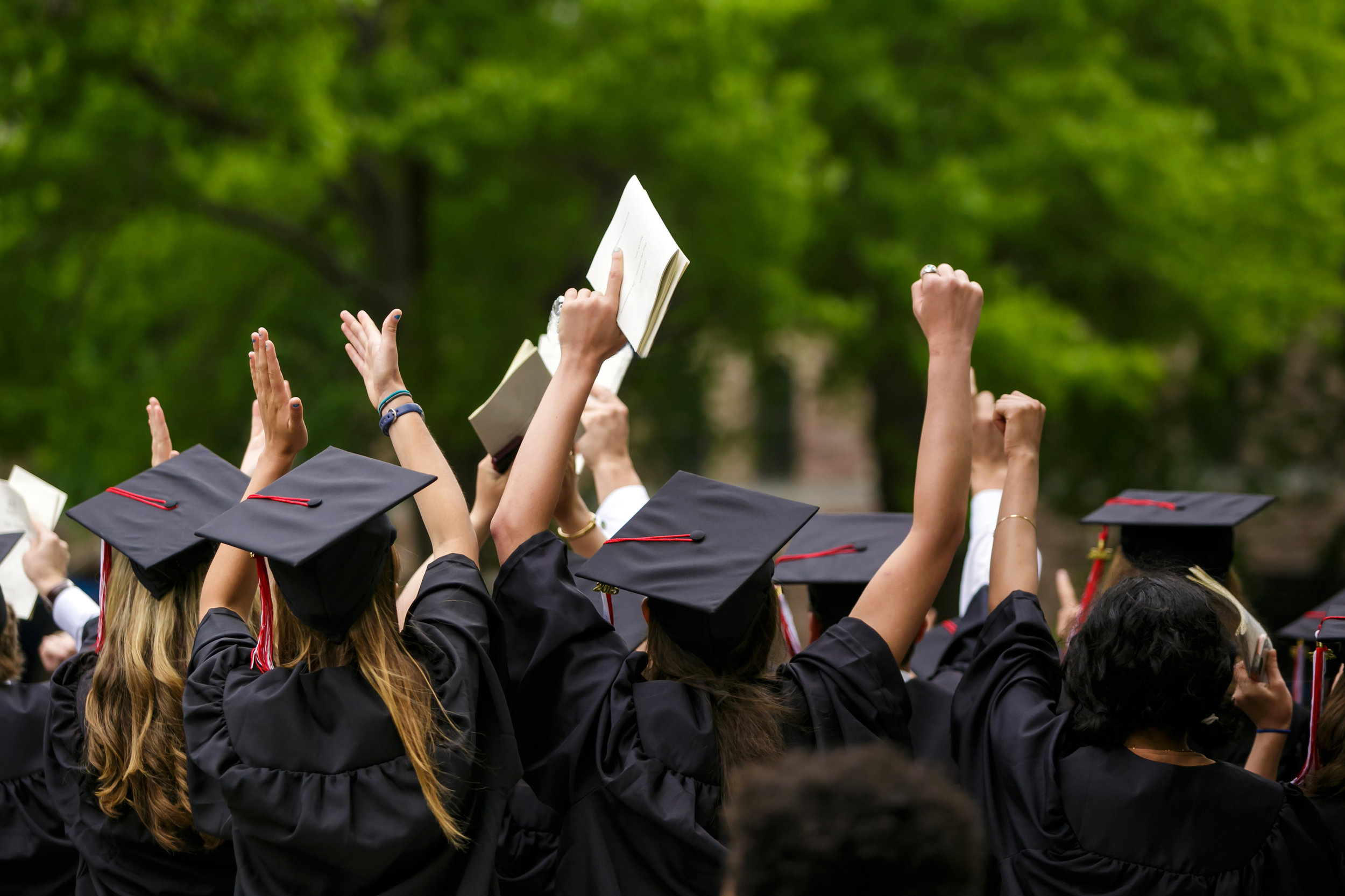 Improve alumni engagement with social login, and account linking with enterprise SSO– photo shows graduates celebrating in their caps and gowns