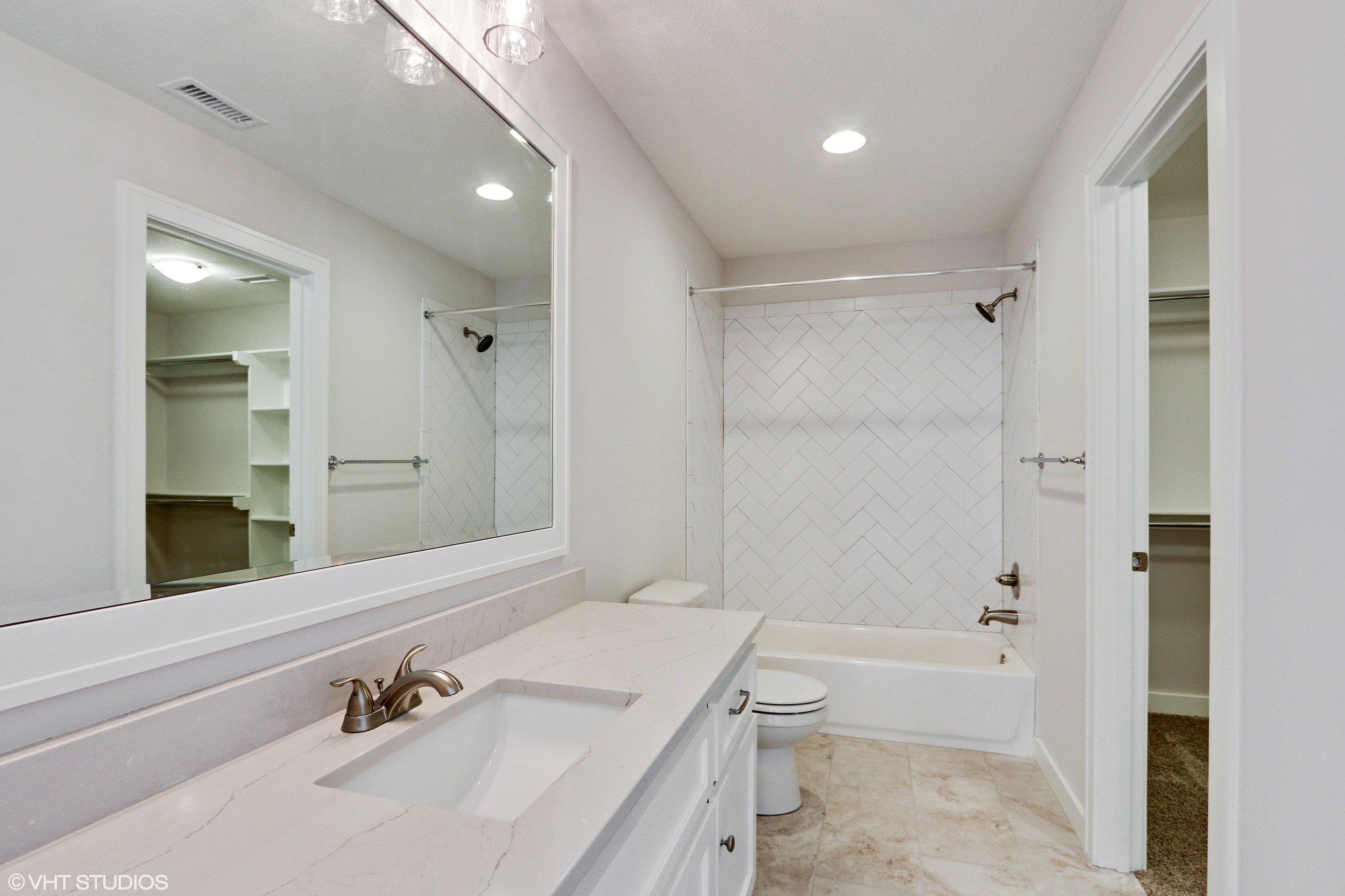 23_10306StonehausDrive_8_Bathroom_HiRes.jpg