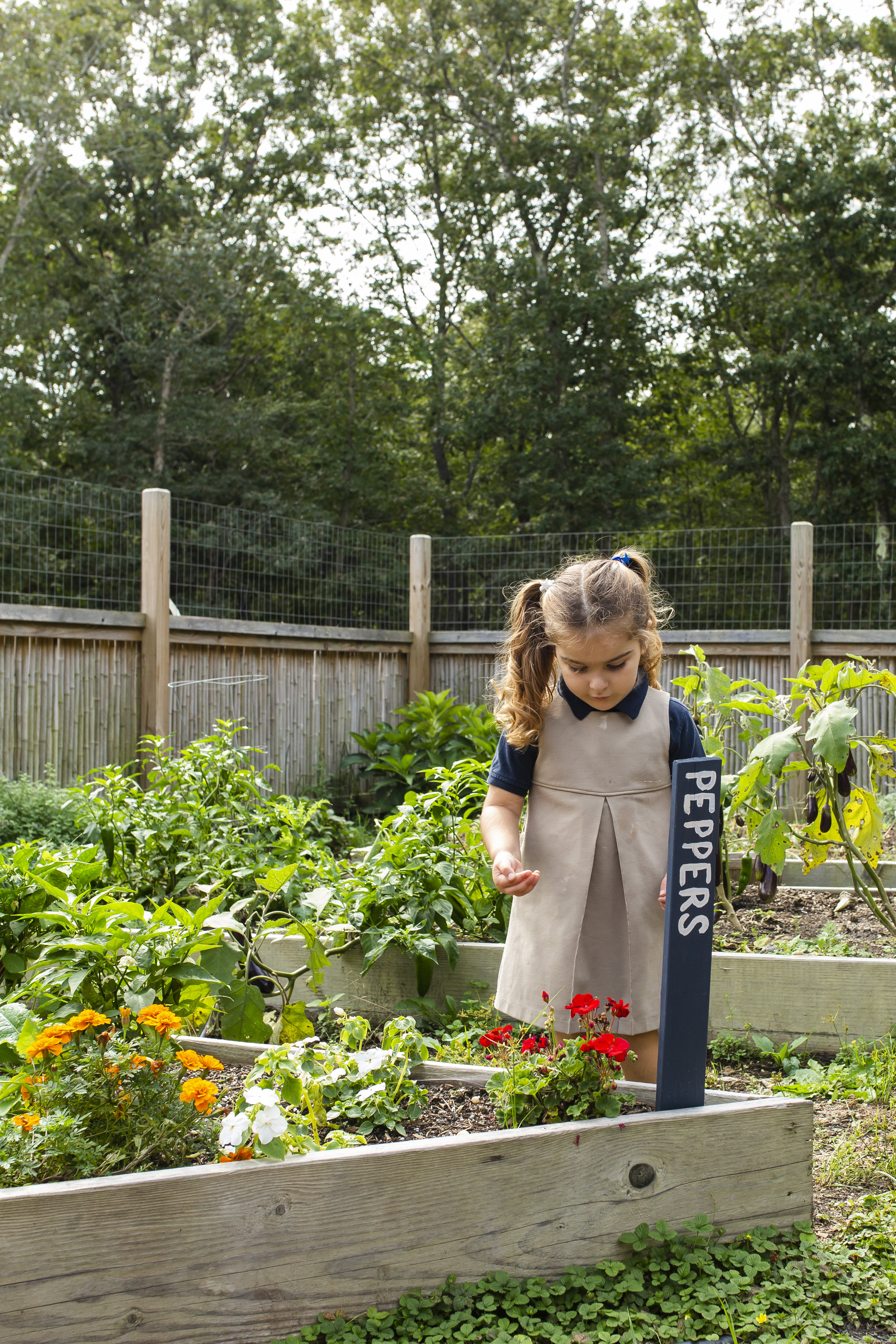 Ross Early Childhood Student Spending Time Outdoors in the Ross Spiral Garden
