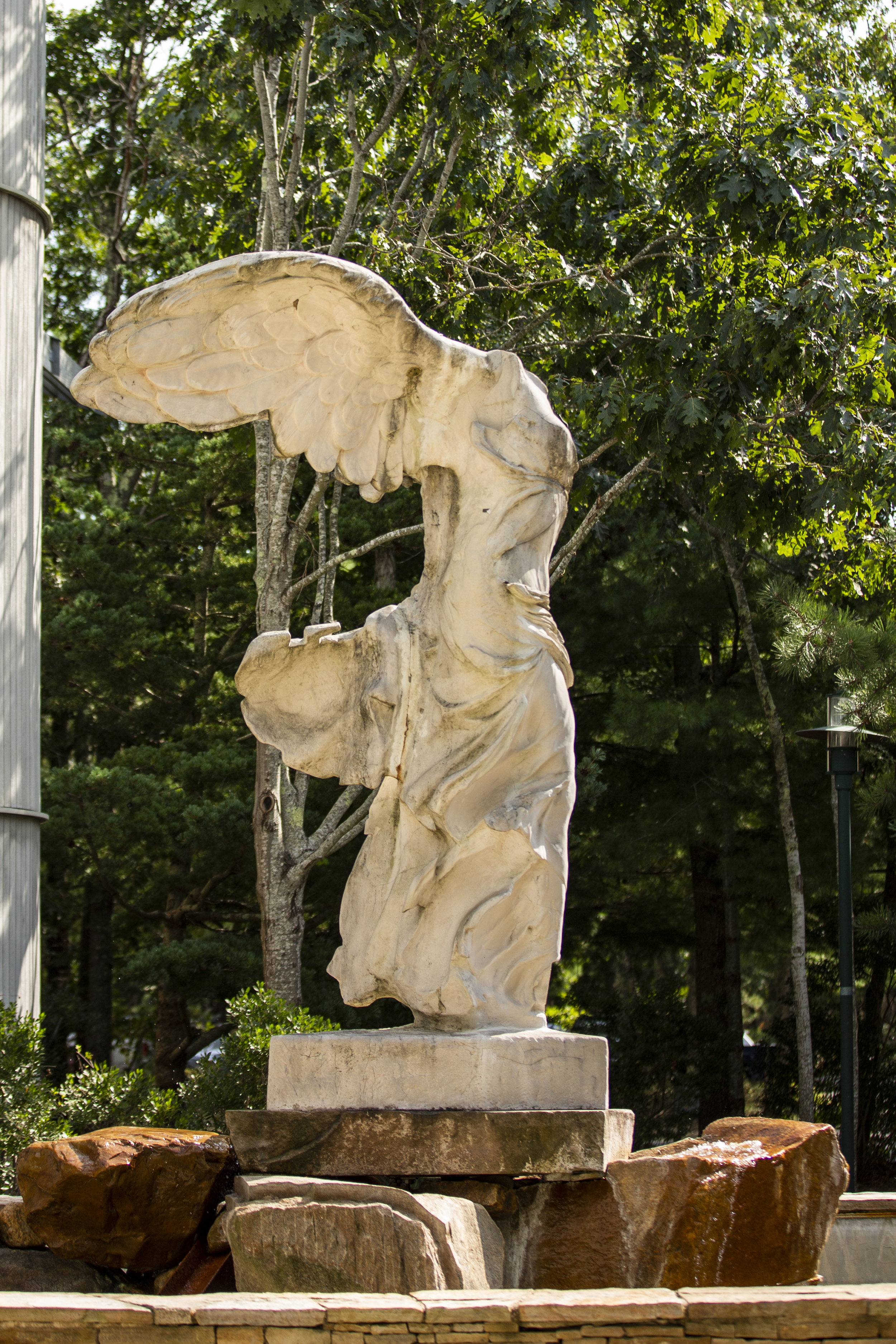 A full-size reproduction of  Nike of Samothrace , aHellenistic sculptureoftheGreek goddessof victory located outside the High School building.