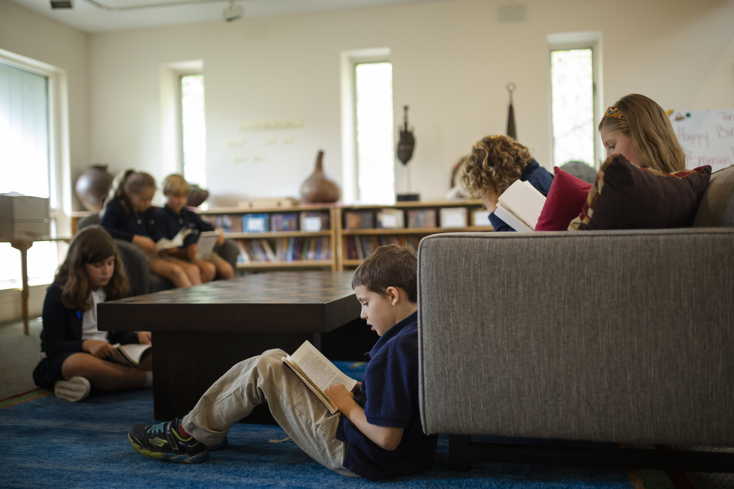 Students engaged in independent reading in one of the Ross School libraries.