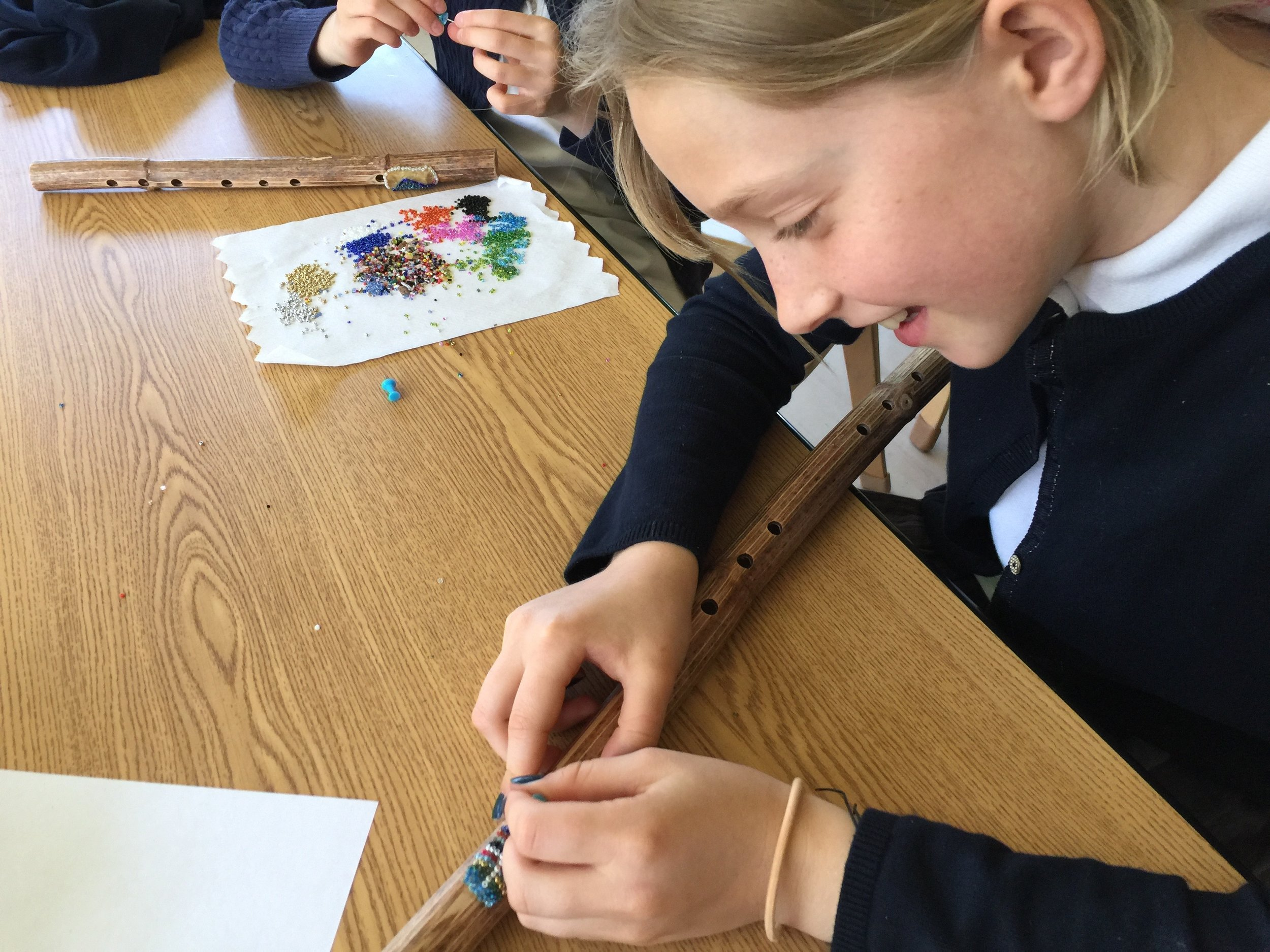 Elementary students learn about ancient instruments as part of integrated lessons involving Cultural History and Performing Arts