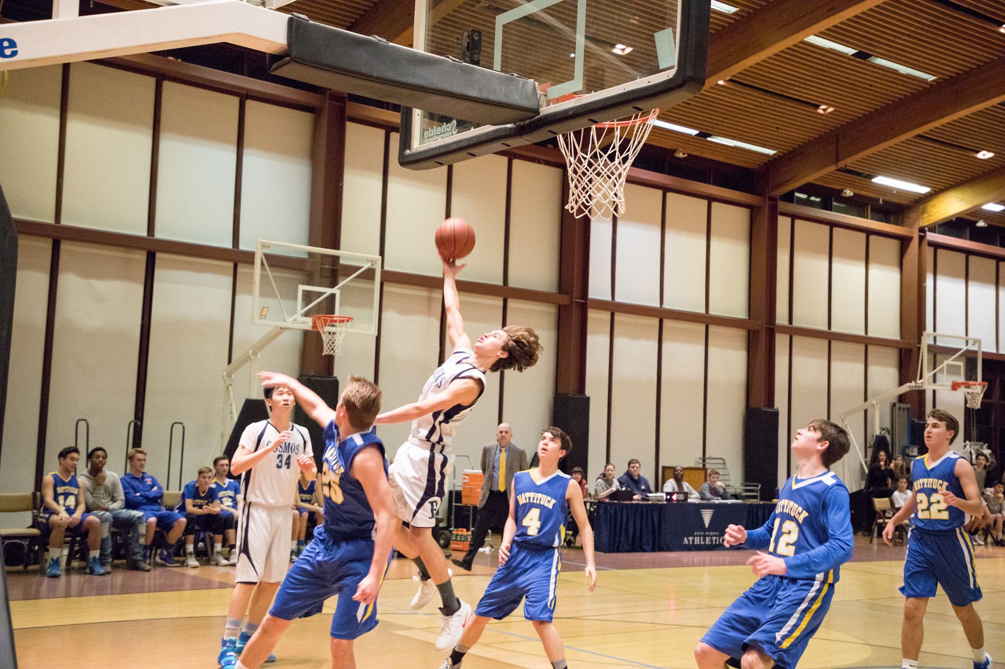 Ross Boy's High School Basketball players in the midst of an interscholastic game.