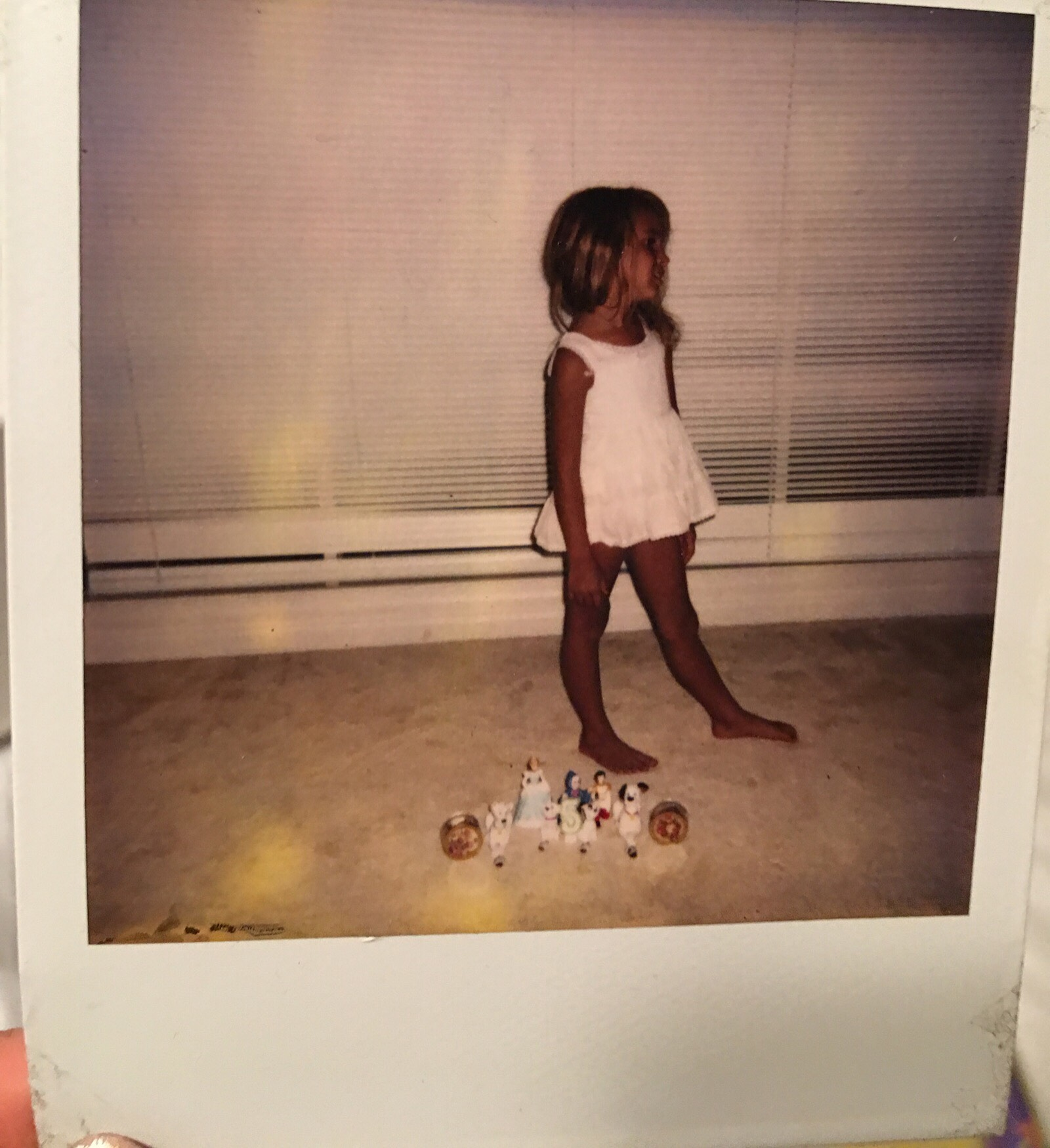 """I remember this like it was yesterday! I begged my sister take this Polaroid of me """"modeling"""" ....and duh my glass Dalmatians made the perfect scene"""