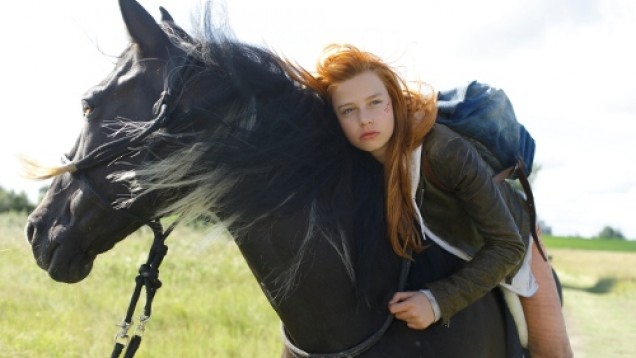 Troubled teenager Mika and untamable black stallion Ostwind in the 2013 movie.