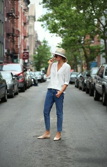 Have the hem of your jeans hit above the ankle bone for a perfect look when wearing flats.