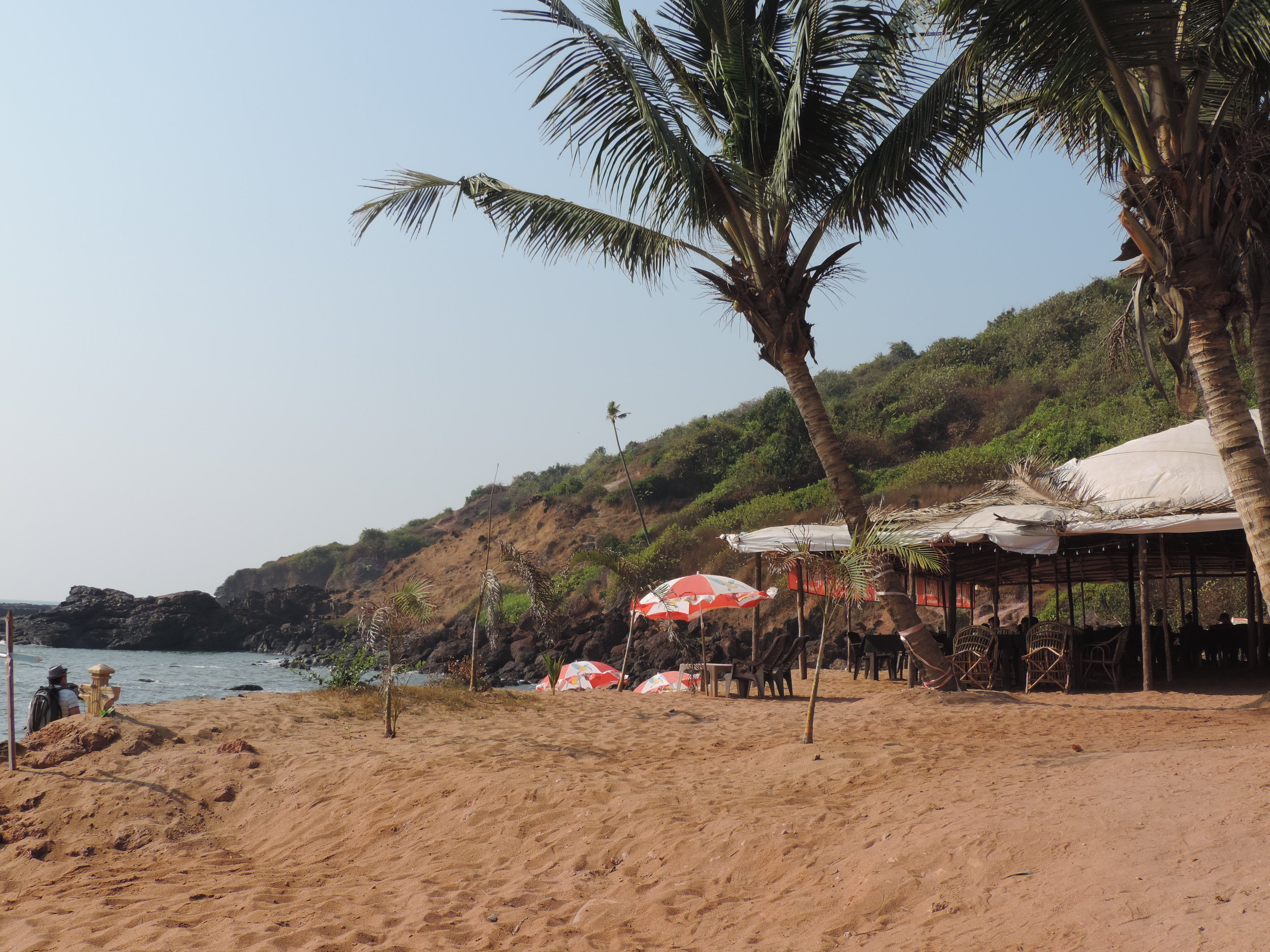 Sipping cold beer on a hot beach in India.
