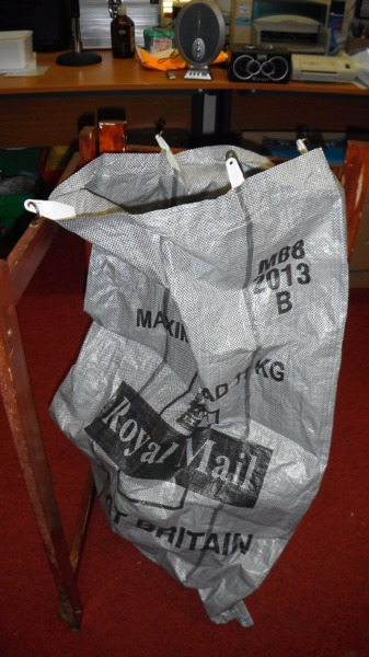 A Royal Mail bag waits patiently for the yellow wallets to mail out free to our listeners