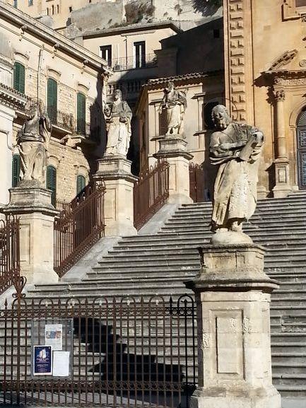 Statues guard the staircase Chiesa di San Pietro