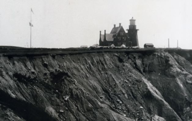 Postcard of Southeast Light on Block Island before the structure was moved.
