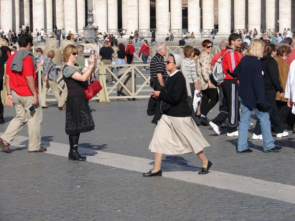 A nun rushes across the square at the Vatican (photo: Brent Petersen)