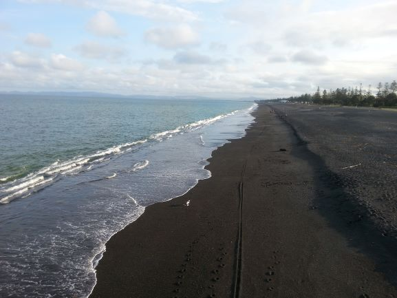 Black sand beach near the Marine Parade, Napier, New Zealand