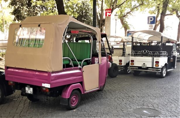 Lisbon's ubiquitou s  Tuk Tuk's. An expensive way to get around town (Photo: Brent Petersen)